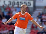 Blackpool's Steven Davies celebrates after scoring the opening goal against Doncaster on August 3, 2013