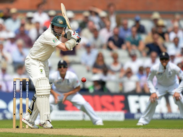 Australia's Chris Rogers plays a shot during play on the first day of the third Ashes cricket test match between England and Australia on August 1, 2013