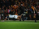 Brumbies' Christian Lealiifano dives in to score a try against the Chiefs during the Super Rugby Final on August 3, 2013