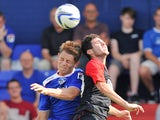 Huddersfield Town's Cristian Lopez out jumps Oldham Athletic's James Tarkowski during a friendly match on May 27, 2013