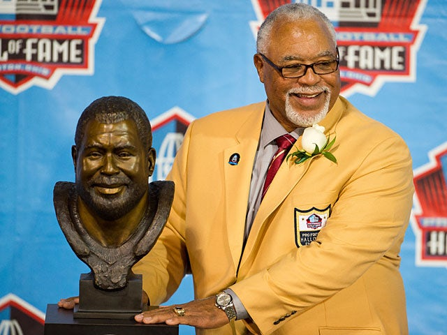 Former Kansas City Chiefs and Houston Oilers defender Curley Culp poses with his bust during the NFL Class of 2013 Enshrinement Ceremony on August 3, 2013