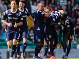 Ross County's Darren Maatsen is congratulated by team mates after scoring the opening goal against Celtic on August 3, 2013