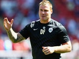 Barnsley's David Flitcroft on the touchline during the match against Wigan on August 3, 2013