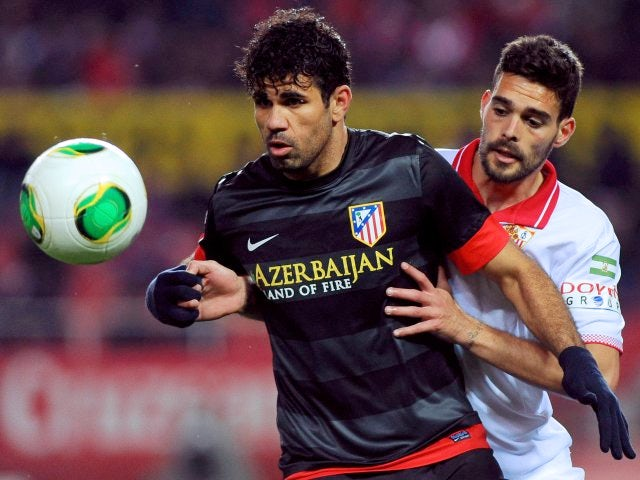 Diego Costa keeps control of the ball against Sevilla.
