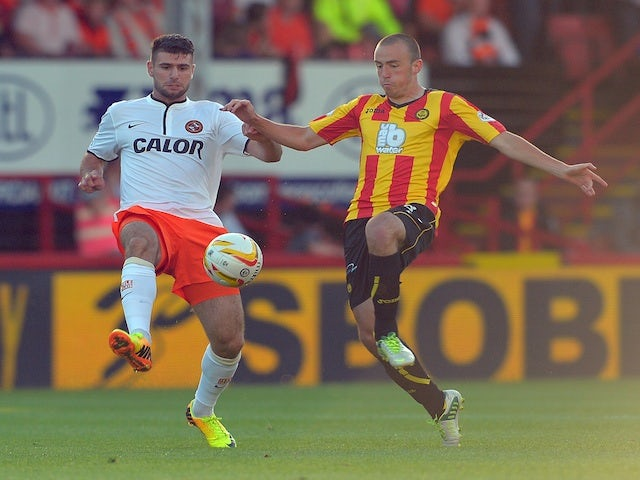 Players from Dundee United and Partick Thistle in action during their SPL game on August 2, 2013