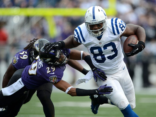 Dwayne Allen of the Indianapolis Colts runs for yards after the catch against Cary Williams of the Baltimore Ravens on January 6, 2013