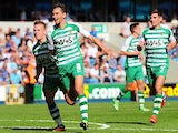 Yeovil's Edward Upson celebrates with team mates after grabbing a late winner against Millwall on August 3, 2013