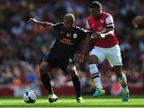 Galatasaray's Felipe Melo and Arsenal's Alex Oxlade Chamberlain battle for the ball during a friendly match on August 4, 2013