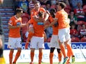 Blackpool's Gary Mackenzie is congratulated by team mates after scoring against Doncaster on August 3, 2013