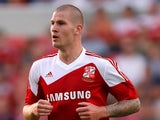 Swindon's James Collins in action against Tottenham on July 16, 2013