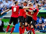 Ipswich's Jay Tabb is mobbed by team mates after scoring the opening goal against Reading on August 3, 2013