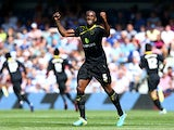Sheffield Wednesday's Kamil Zayatte celebrates after scoring the opening goal against QPR on August 3, 2013