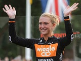 Laura Trott waves to fans as she celebrates winning the Pro Women's Grand Prix during the Prudential RideLondon on August 3, 2013