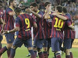 FC Barcelona's players celebrate scoring against Lechia Gdansk during their friendly match on July 30, 2013