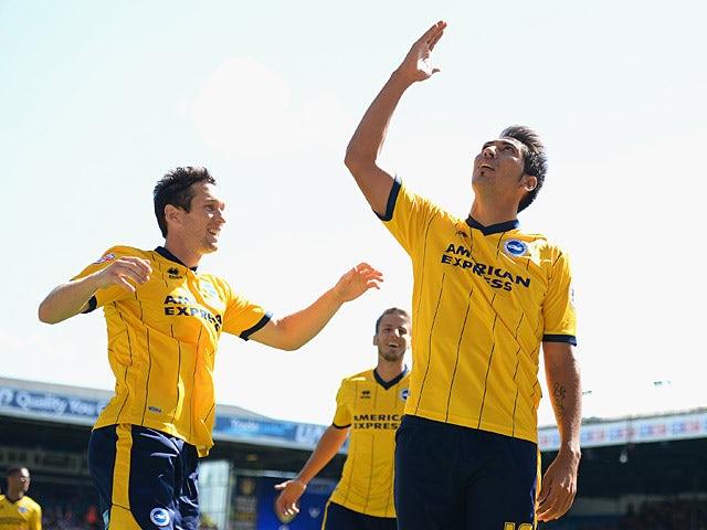 Brighton's Leonardo Ulloa celebrates moments after scoring the opening goal against Leeds on August 3, 2013