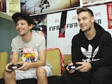 One Direction's Louis Tomlinson and Liam Payne play FIFA 14