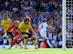 Leed's Luke Murphy celebrates moments after scoring the winner against Brighton on August 3, 2013