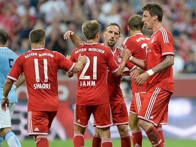Bayern's Mario Mandzukic is congratulated by team mates after scoring the second goal against Manchester City on August 1, 2013