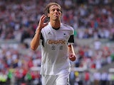 Swansea's Michu celebrates after scoring the opening goal against Malmo on August 1, 2013