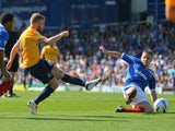 Alfie Potter of Oxford scores his side's third goal during the Sky Bet League Two match between Portsmouth and Oxford United on August 3, 2013