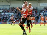 Doncaster's Rob Jones is congratulated by team mates after scoring a penalty to equalise against Blackpool on August 3, 2013
