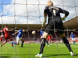 Leicester's Sean St Ledger-Hall heads in an own goal during the match against Middlesbrough on August 3, 2013