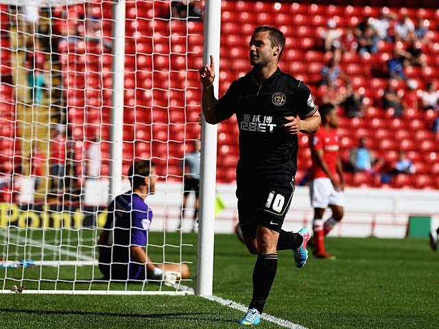 Wigan's Shaun Maloney celebrates after scoring his team's fourth goal against Barnsley on August 3, 2013