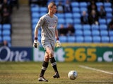 Simon Moore in action for Brentford on April 6, 2013