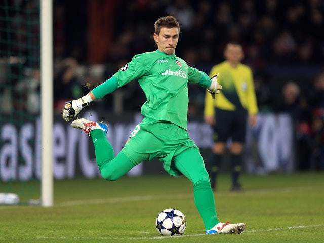 Valencia goalkeeper Vicente Guaita kicks the ball during the Champions League match against Paris Saint-Germain on March 6, 2013
