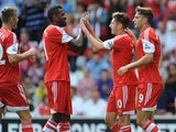 Southampton's Adam Lallana is congratulated by team mates after scoring against Real Sociedad during a friendly match on August 10, 2013