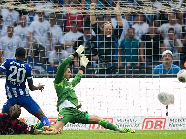 Hertha Berlin's Adrian Ramos scores the opening goal against Eintracht Frankfurt on August 10, 2013