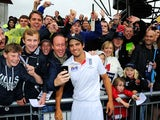 England captain Alastair Cook celebrates with fans after retaining the Ashes on August 5, 2013