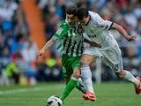 Alvaro Vadillo battles for possession with Real Madrid defender Pepe.