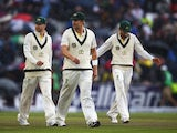 Michael Clarke, Shane Watson and Nathan Lyon of Australia walk off as rain falls during day five of the 3rd Investec Ashes Test match between England and Australia on August 5, 2013