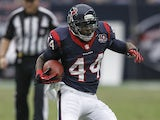 Ben Tate of the Houston Texans rushes past the block of Duane Brown of the Houston Texans on December 23, 2012