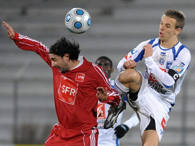 Auxerre's Benoit Pedretti and Ajaccio's Ludovic Asuarl battle for the ball on January 3, 2009
