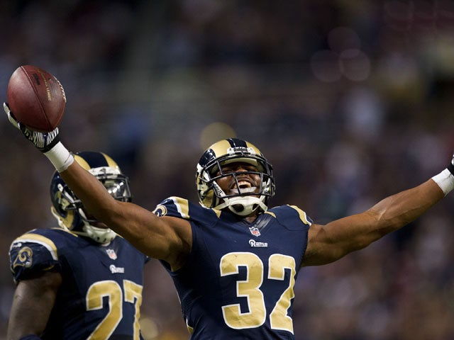 Cornerback Bradley Fletcher #32 of the St. Louis Rams celebrates after catching an interception late in the fourth quarter during the game against the Seattle Seahawks on September 30, 2012