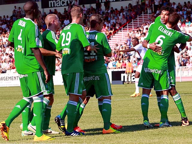 Saint-Etienne's Brandao is congratulated by team mates after scoring against Ajaccio on August 11, 2013