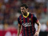 Barcelona's Cesc Fabregas in action during a friendly match against Thailand XI on August 7, 2013
