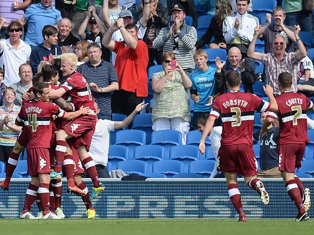 Derby's Chris Martin is mobbed by team mates after scoring his second goal against Brighton on August 10, 2013
