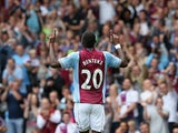 Villa's Christian Benteke celebrates after scoring his second goal against Malaga during a friendly match on August 10, 2013