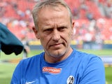 Freiburg's head coach Christian Streich prior to kick-off against Bayer Leverkusen on August 10, 2013