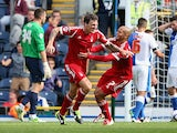 Nottingham Forest's Darius Henderson is congratulated by team mate Adlene Guedioura after scoring the winner against Blackburn on August 10, 2013