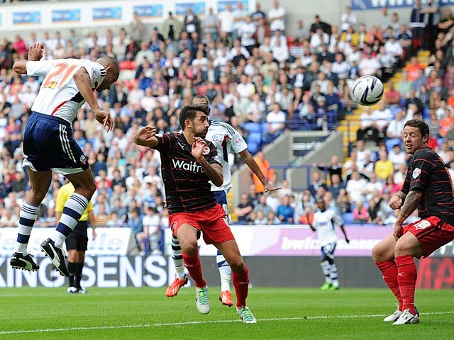 Bolton's Darren Pratley heads in the opening goal against Reading on August 10, 2013