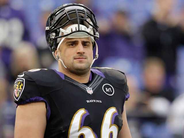 Guard Gino Gradkowski of the Baltimore Ravens looks on before the start of the Ravnes game against the Pittsburgh Steelers on December 2, 2012