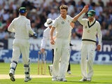 Australia's Jackson Bird is congratulated by team mates after dismissing England's James Anderson on day 2 of the 4th Ashes Test on August 10, 2013