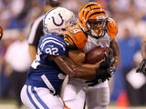 Jerry Hughes of the Indianapolis Colts tackles Daniel Herron of the Cincinnati Bengals on August 30, 2012