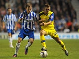Ashley Barnes of Brighton challenges Joe Mattock of Sheffield Wednesday during the npower Championship match between Brighton & Hove Albion and Sheffield Wednesday at Amex Stadium on September 14, 201