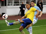 Arsenal's Kieran Gibbs and Manchester City's James Milner battle for the ball during a friendly match on August 10, 2013