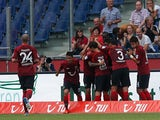 Hannover's Leon Andreasen is mobbed by his team mates after scoring the opening goal against Wolfsburg on August 10, 2013